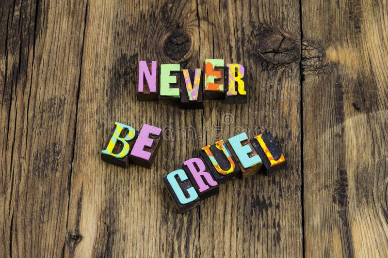 Never be cruel mean dishonest corrupt bully angry. Letterpress letters nice kind kindness help charity faith hope love honest royalty free stock images