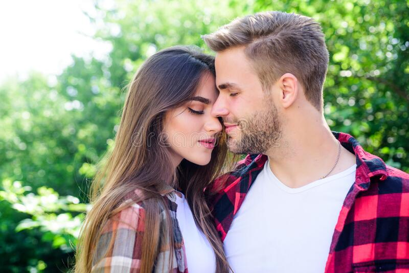 Never boring. couple in love. Hiking. hipster couple outdoor. family weekend. romantic date. man and woman in checkered royalty free stock photo