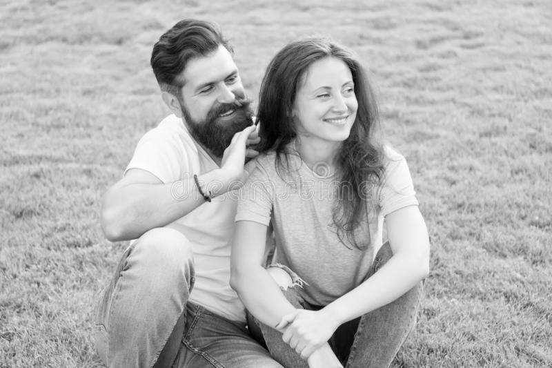 Never boring. summer relax in park. family weekend. cute girl and bearded man hipster on green grass. fashion couple stock images