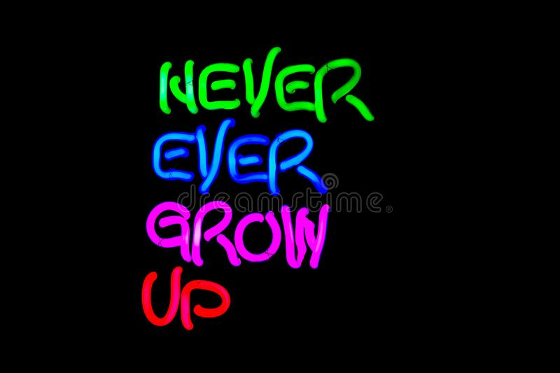 Never ever grow up neon sign. royalty free stock images