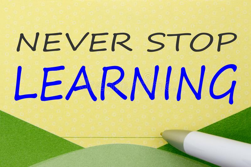 Never Stop Learning written on note stock photos