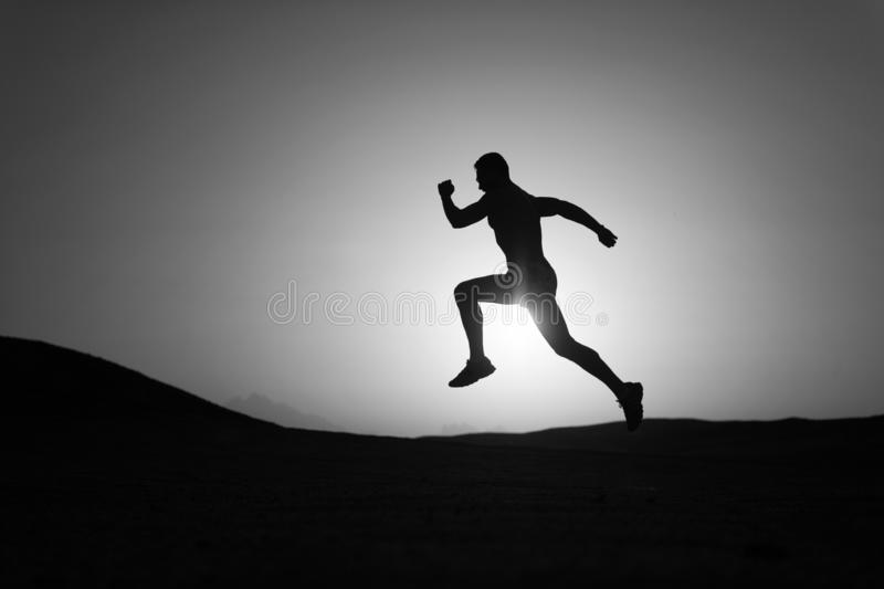 Never stop. Silhouette man motion running in front of sunset sky background. Future success depends on your efforts now. Daily motivation. Healthy lifestyle royalty free stock images
