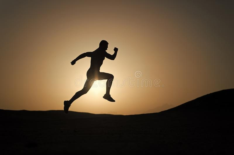 Never stop. Silhouette man motion running in front of sunset sky background. Future success depends on your efforts now royalty free stock photography