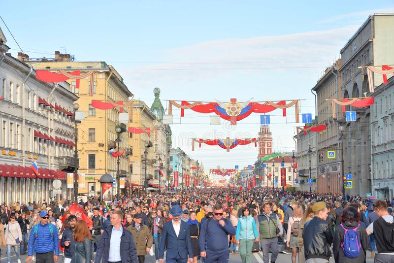 Nevsky prospect on Victory Day. ST.PETERSBURG, RUSSIA: - MAY 9, 2019: Residents of St.Petersburg walk on Nevsky prospect on Victory Day. The celebration of 74 royalty free stock photography