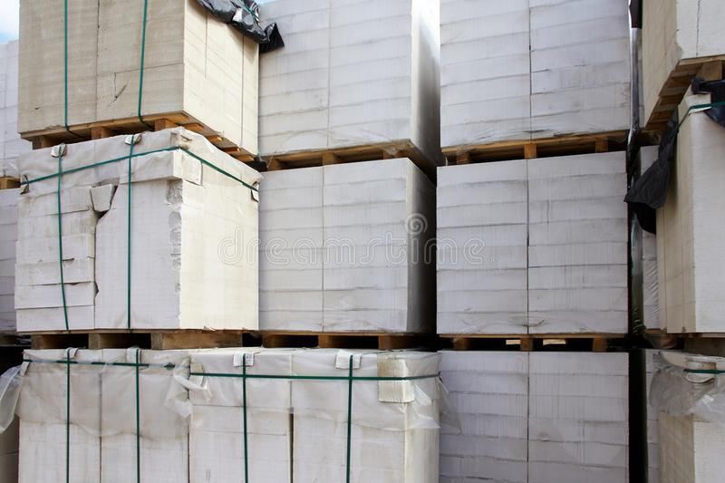 New aerated concrete blocks on pallets stored at warehouse.  royalty free stock images