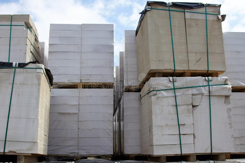New aerated concrete blocks on pallets stored at warehouse.  royalty free stock photos