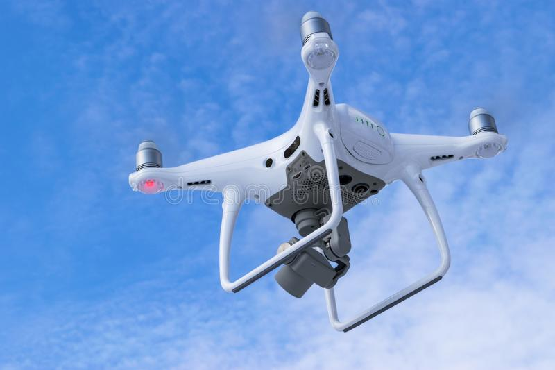 The New Aircraft DJI Phantom 4 pro quadcopter drone with 4K video camera and wireless remote controller flying in the sky. Aerial. Sankt-Petersburg, Russia stock images
