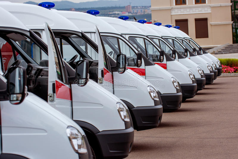 New ambulances in line. Russia - Septeber, 2016: New ambulance cars waiting in line to be delivered royalty free stock photo