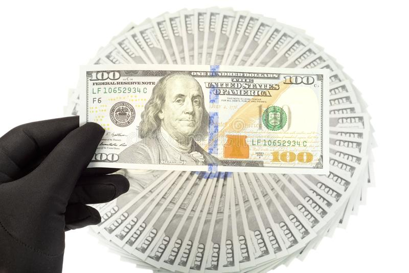 New Ameican dollars. New American 2013 hundred Dollars ,hand with black glove on it royalty free stock photography