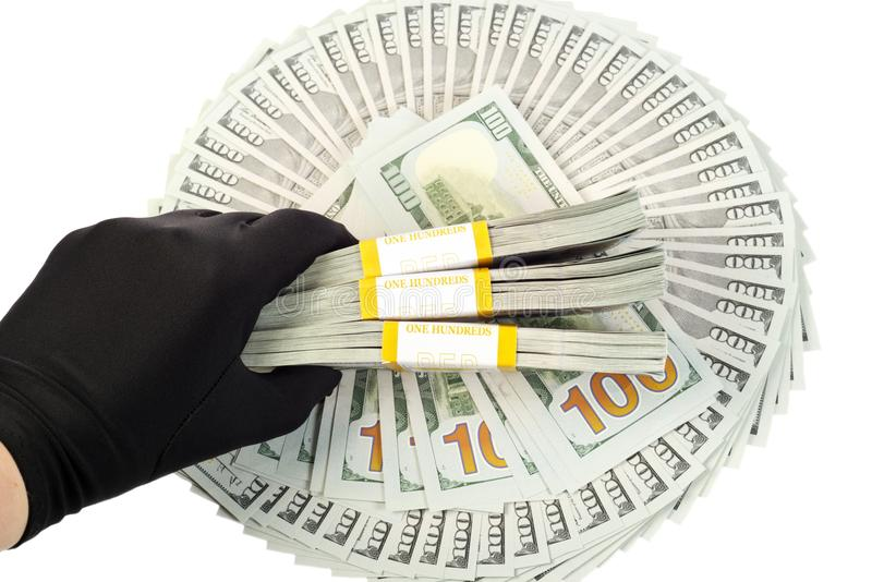 New Ameican dollars. New American 2013 hundred Dollars ,hand with black glove on it royalty free stock image