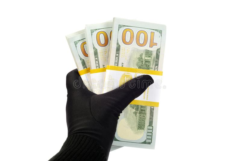 New Ameican dollars. New American 2013 hundred Dollars ,in a hand with black glove on it royalty free stock images