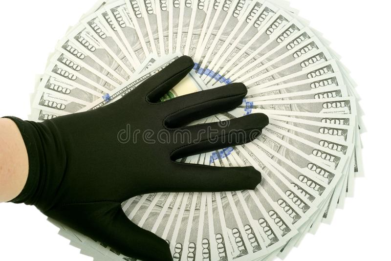 New Ameican dollars. New American 2013 hundred Dollars ,hand with black glove on it stock photography