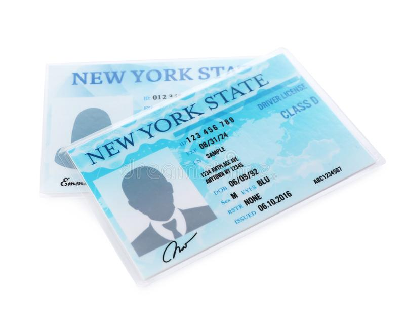 New American driving licenses on white. Background stock images