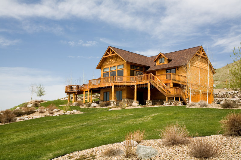 New american home. House on a hillside, beautiful brand new home in a rural setting with copyspace royalty free stock photography