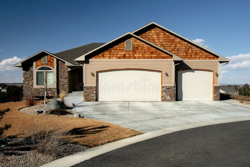New american home. Recently constructed. house on a hill with blue sky background stock photography