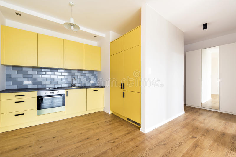 New apartment, empty room with domestic kitchen. Interior design royalty free stock images