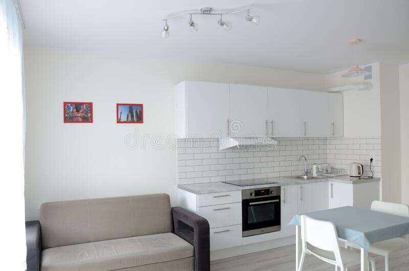New apartment with kitchenette and sofa royalty free stock image