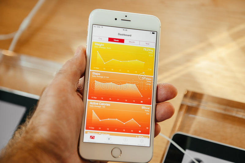 New Apple iPhone 6 and iPhone 6 plus. PARIS, FRANCE - SEPTEMBER 20, 2014: Hand holding a iPhone 6 Plus displaying dashboard of the new Health App during the stock photography
