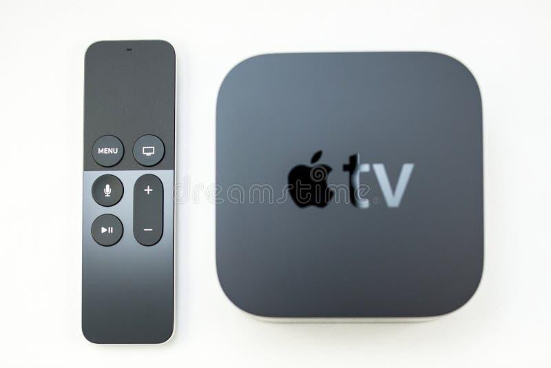 New Apple TV media streaming player microconsole. PARIS, FRANCE - NOV 10, 2015: New Apple TV media streaming player microconsole by Apple Computers next to the stock photo