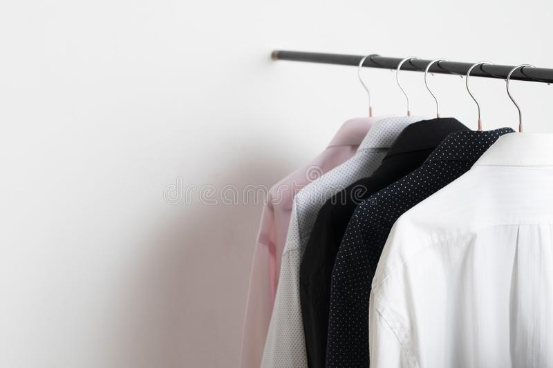 New arrival Shirts hanging on rack in shopping mall. Long sleeve Shirts hanging on rack in shopping mall stock photography