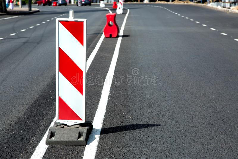 New asphalt pavement and fresh road markings. stock photo