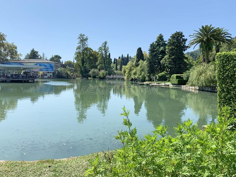 New Athos, Abkhazia, August, 09. 2019. Small cafe on the bank of one of the many ponds in summer royalty free stock images