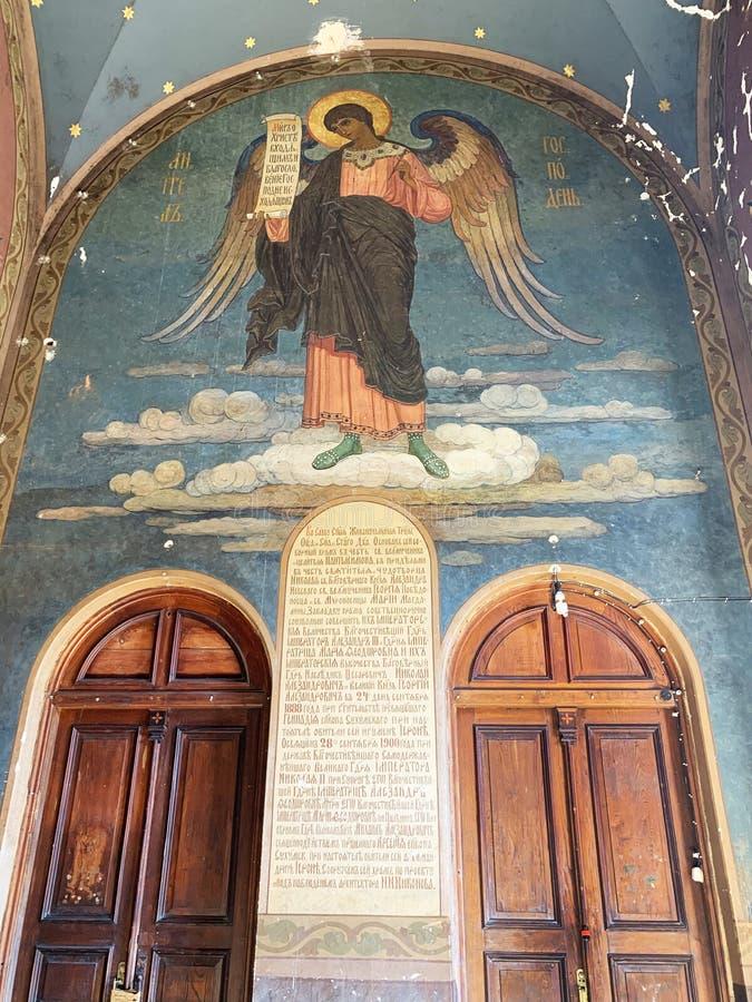 New Athos monastery. Abkhazia. Interiors. The image of St. Panteleimon, thrown by the beast, in the interior.  stock image