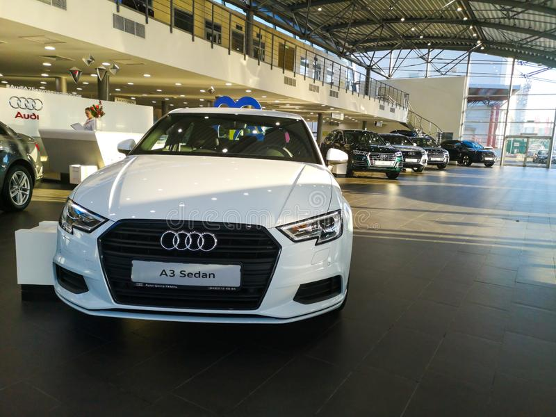 The new Audi A3 car with LED lights is sold in the car salon on December 20 2019 at the address Russian Federation city Kazan. The new Audi A3 sedan with LED royalty free stock photo