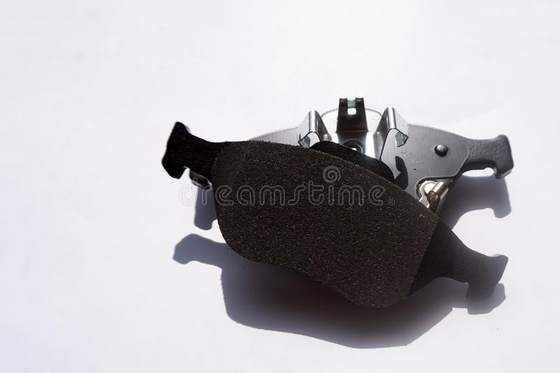New auto brake pads on grey background royalty free stock photography