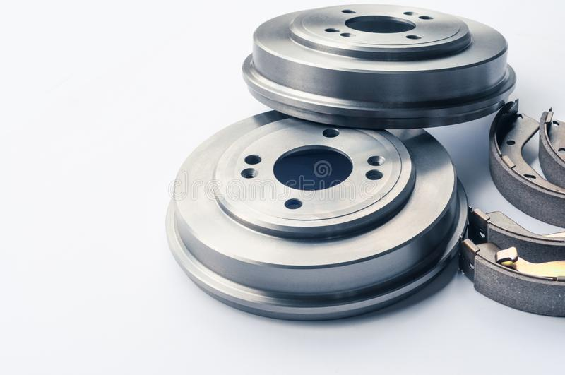 New auto parts brake drums, pads, cylinders on white background royalty free stock photos