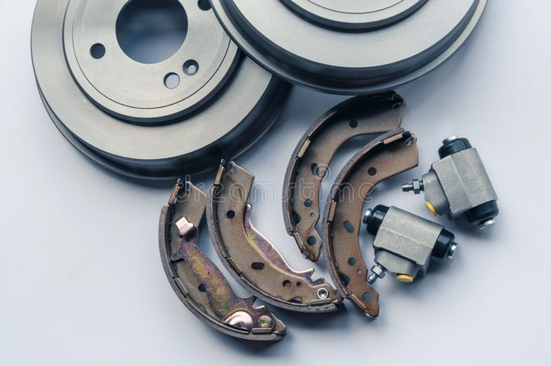 New auto parts brake drums, pads, cylinders on white background stock photo