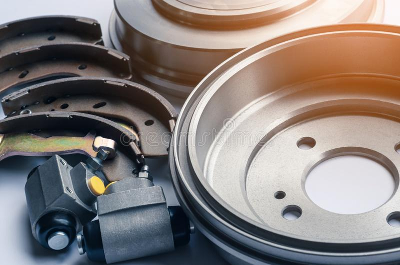 New auto parts brake drums, pads, cylinders on white background royalty free stock photo