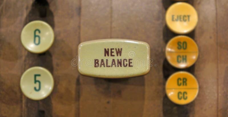 New Balance button on old automated banking machine. stock photo