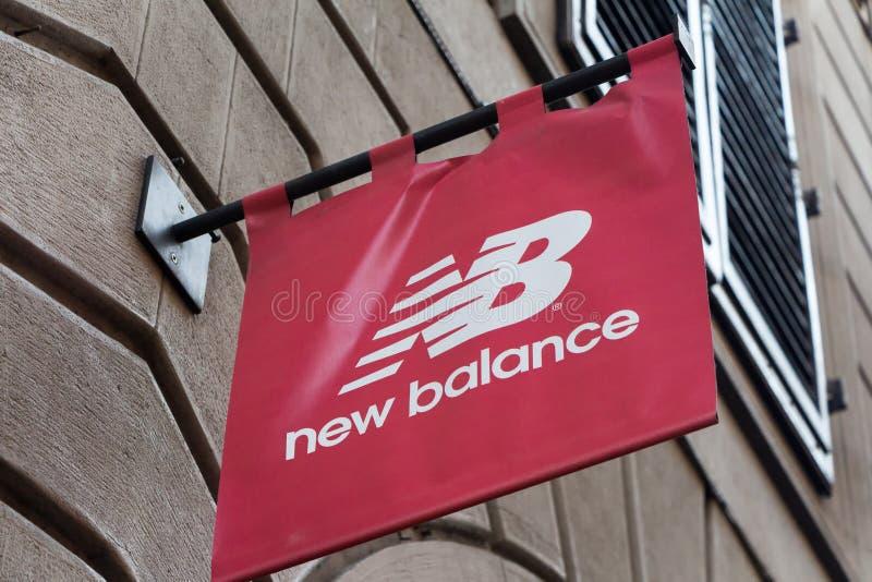 New Balance logo on New Balance`s shop. Florence, Italy - OCTOBER 25, 2018: New Balance logo on New Balance`s shop. New Balance is an american sports footwear royalty free stock photos