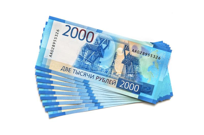 New banknotes worth 2000 rubles isolated. On white background. a pack of Russian banknotes in denominations of 2000 rubles stock photos