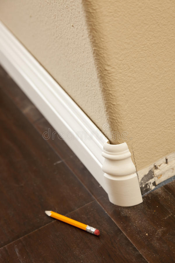 New Baseboard and Bull Nose Corners with Laminate Flooring. Abstract royalty free stock photos
