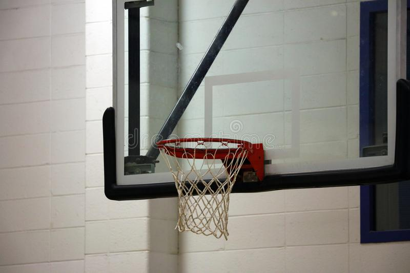 New basketball hoop at kids sports center. During game stock photography