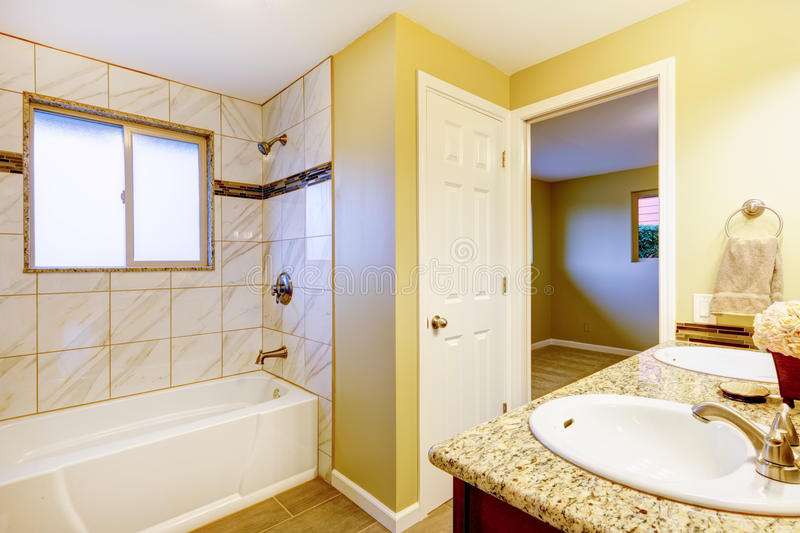 New bathroom interior with cherry sink cabinet. stock photo