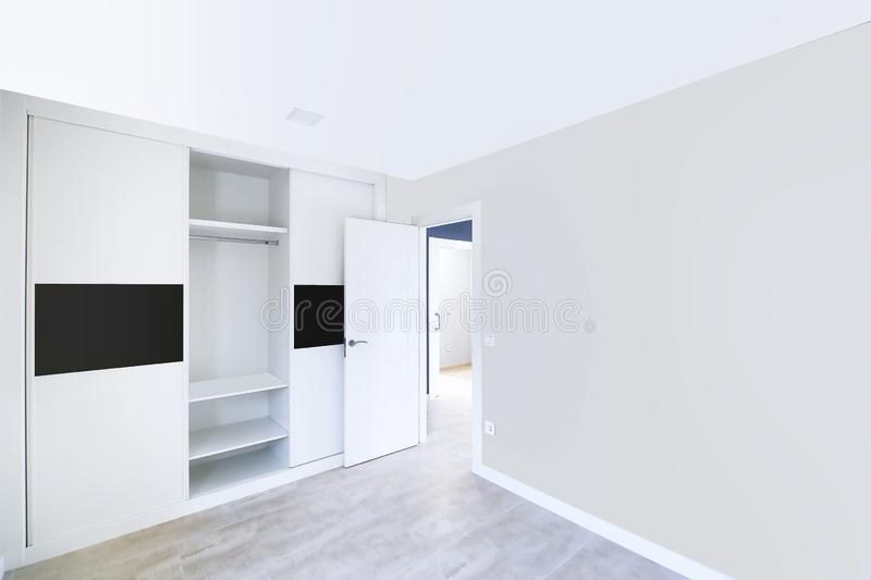 New beautiful empty room with built-in wardrobes. Interior modern room royalty free stock image
