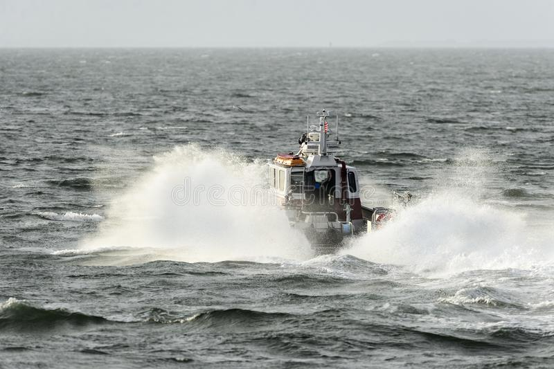 New Bedford Fire Rescue boat. New Bedford, Massachusetts, USA - November 1, 2017: New Bedford Fire Rescue boat pounding through southeasterly chop en route to stock images
