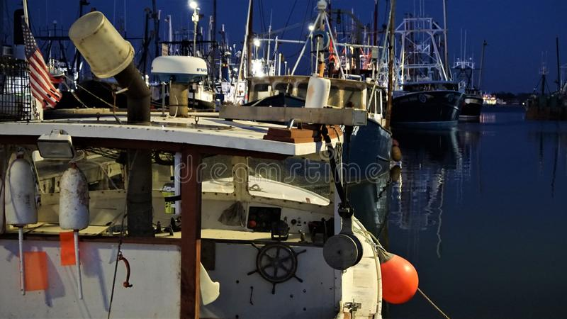 New Bedford fishing fleet in port at night royalty free stock photography