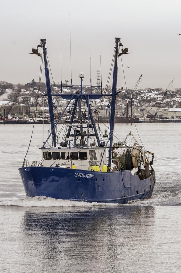 Dragger United States leaving port. New Bedford, Massachusetts, USA - December 4, 2019: Commercial fishing boat United States on her way out of New Bedford stock photo