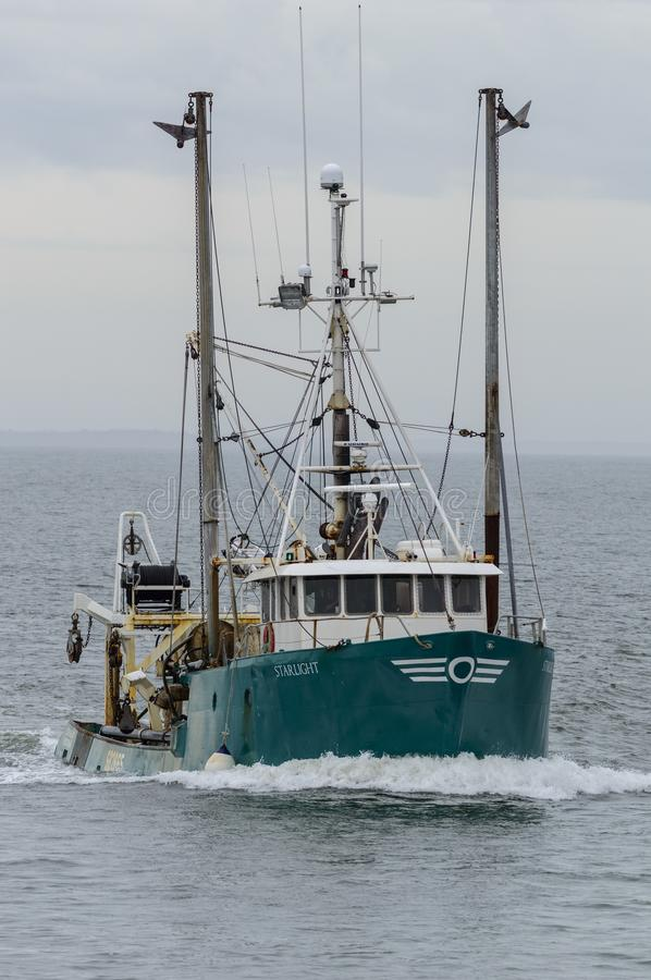 Commercial fishing vessel Starlight heading into New Bedford harbor stock image