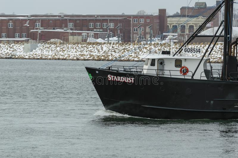 Prow of F/V Stardust. New Bedford, Massachusetts, USA - February 1, 2018: Fishing vessel Stardust heading into Buzzards Bay on snowy morning royalty free stock photos