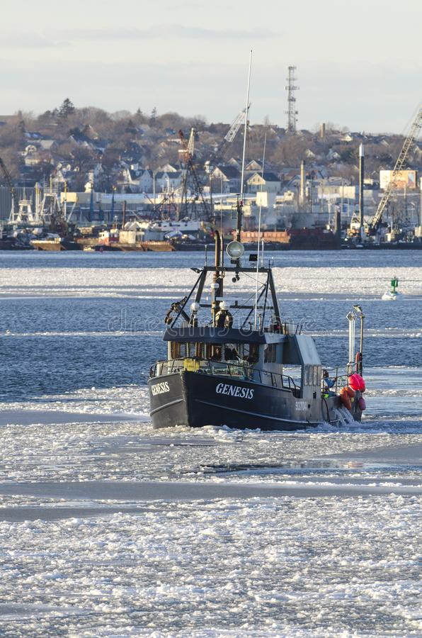 Commercial fishing boat Genesis in icy New Bedford harbor royalty free stock photography