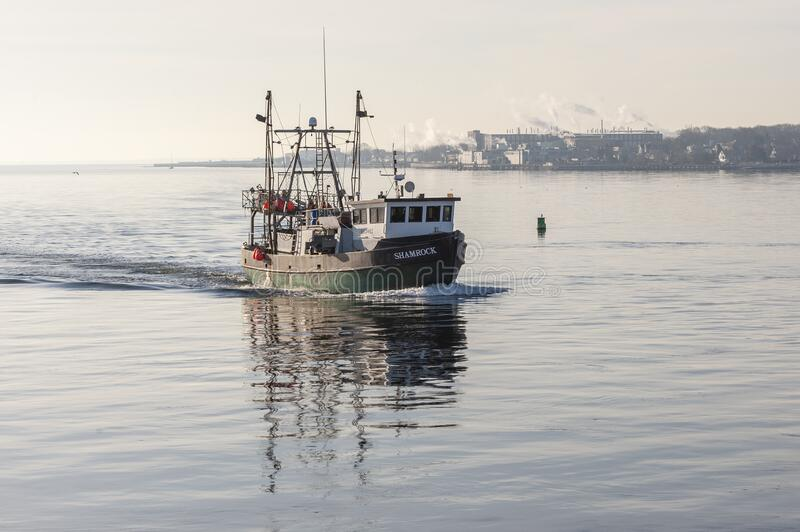 Commercial fishing vessel Shamrock homebound in New Bedford outer harbor royalty free stock images