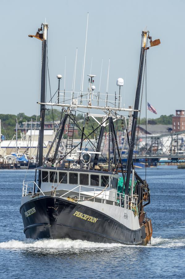 Dragger Perception crossing New Bedford harbor. New Bedford, Massachusetts, USA - June 4, 2019: Commercial fishing vessel Perception leaving New Bedford on stock images