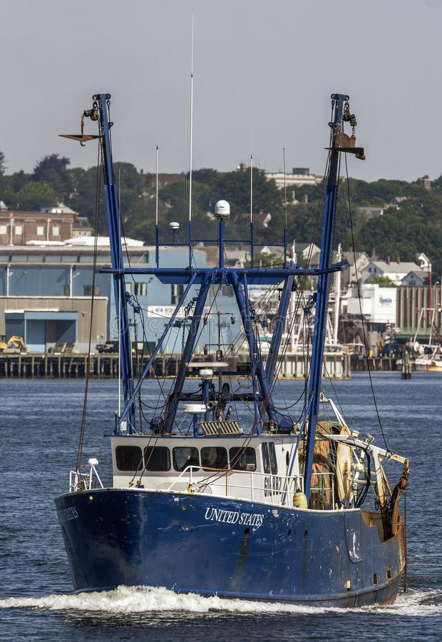 Trawler United States crossing New Bedford harbor. New Bedford, Massachusetts, USA - June 24, 2019: Commercial fishing vessel United States going fishing royalty free stock images