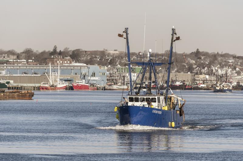 Trawler United States outbound. New Bedford, Massachusetts, USA - March 9, 2020: Commercial fishing boat United States heading out of New Bedford royalty free stock photo