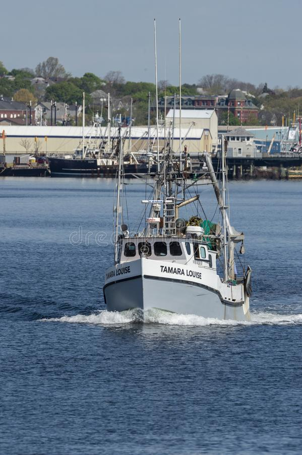 Commercial fishing boat Tamara Louise with New Bedford waterfront in background. New Bedford, Massachusetts, USA - May 16, 2019: Commercial fishing vessel Tamara royalty free stock photos